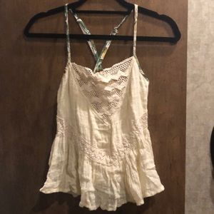 Cream flowy top with lace accents